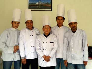 Kabita Gurung celebrates her graduation from the Journey Home  Foundation with her instructors. Kabita has already secured a  position as one of the chefs at the Hotel Crystal in Pokhara, a tourist destination in the Himalayas.