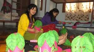 Sunisha crafting hats for the market
